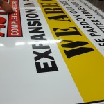 Applying the printed vinly to the sign