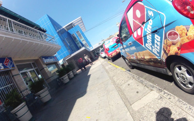 Domino's Pizza vehicle parked near business